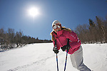 Young woman having fun skiing at Stratton Mountain Resort on a perfect spring day, 2009