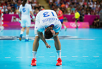 08 AUG 2012 - LONDON, GBR - Nikola Karabatic (FRA) of France holds his head after injuring it in a challenge during the men's London 2012 Olympic Games quarter final match against Spain at the Basketball Arena in the Olympic Park, in Stratford, London, Great Britain(PHOTO (C) 2012 NIGEL FARROW)