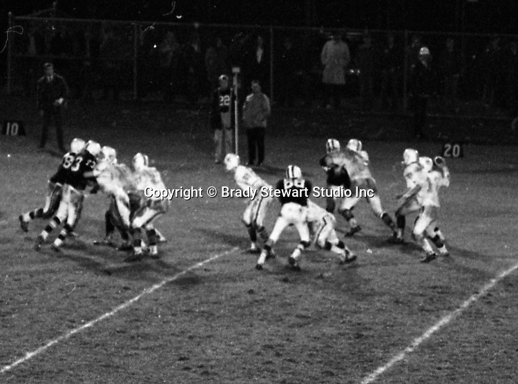 Bethel Park PA: Mike Stewart throwing a completed pass to Bruce Evanovich after excellent blocks from everyone.  Others in the photo; Bruce Evanovich 80, Chip Huggins 32, Clark Miller 30, Dan Hannigan 64, Dennis Franks 66, Don Troup 51, Joe Barrett 75, Mike Stewart 11.  The Bethel Park offense and defense played very well in the 16-0 shut-out of the Upper St Clair Panters.  The defensive unit was one of the best in Bethel Park history only allowing a little over 7 points a game.