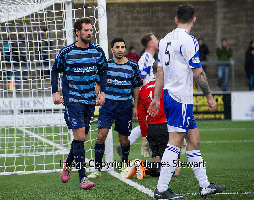 Forfar's Gavin Swankie celebrates towards Peterhead's Scott Ross after they clashed as he scored their second goal.