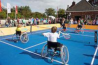 15-09-12, Netherlands, Amsterdam, Tennis, Daviscup Netherlands-Suisse, Kids in wheelchair playing tennis