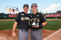 Cooper Johnson (25) of Carmel Catholic High School in Mundelein, Illinois poses for a photo with Steve Bernhardt after being announced as the Kelly Kulina Award recipient after the Under Armour All-American Game on August 15, 2015 at Wrigley Field in Chicago, Illinois. (Mike Janes/Four Seam Images)