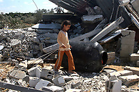 """Palestinian girl stand on top of the rubble of a house, which was demolished by the Israeli army during a military operation, in Gaza September 21, 2007.""""photo by Fady Adwan """""""