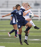 Springdale Har-Ber's Ashley Osorio (18) and Rogers' Wesley Jackson vie for the ball Tuesday, April 27, 2021, during the first half of play at Wildcat Stadium in Springdale. Visit nwaonline.com/210428Daily/ for today's photo gallery. <br /> (NWA Democrat-Gazette/Andy Shupe)