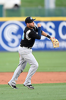Syracuse Chiefs third baseman Brandon Laird (15) throws to first during a game against the Buffalo Bisons on July 23, 2014 at Coca-Cola Field in Buffalo, New  York.  Syracuse defeated Buffalo 5-0.  (Mike Janes/Four Seam Images)