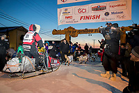 Aliy Zirkle runs into the finish chute and across the line for 15th place  at Nome on Wednesday March 14th during the 2018 Iditarod Sled Dog Race.  <br /> <br /> Photo by Jeff Schultz/SchultzPhoto.com  (C) 2018  ALL RIGHTS RESERVED