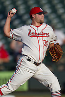 Wearing an Austin Senators throwback uniform, Round Rock Express pitcher Evan Meek (30) delivers a pitch to the plate during the Pacific Coast League baseball game against the Oklahoma City RedHawks on July 9, 2013 at the Dell Diamond in Round Rock, Texas. Round Rock defeated Oklahoma City 11-8. (Andrew Woolley/Four Seam Images)