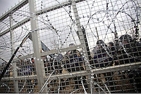 Pictured: FYRO Macedonian police 29 February 2016<br /> Re: A crowd of migrants has burst through a barbed-wire fence on the FYRO Macedonia-Greece border using a steel pole as a battering ram.<br /> TV footage showed migrants pushing against the fence at Idomeni, ripping away barbed wire, as FYRO Macedonian police let off tear gas to force them away.<br /> A section of fence was smashed open with the battering ram. It is not clear how many migrants got through.<br /> Many of those trying to reach northern Europe are Syrian and Iraqi refugees.<br /> About 6,500 people are stuck on the Greek side of the border, as FYRO Macedonia is letting very few in. Many have been camping in squalid conditions for a week or more, with little food or medical help.