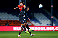 31st October 2020; Kenilworth Road, Luton, Bedfordshire, England; English Football League Championship Football, Luton Town versus Brentford; Tom Lockyer of Luton Town wins a header against Emiliano Marcondes of Brentford