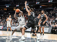 WASHINGTON, DC - FEBRUARY 19: Qudus Wahab #34 of Georgetown holds the ball away from Nate Watson #0 of Providence during a game between Providence and Georgetown at Capital One Arena on February 19, 2020 in Washington, DC.
