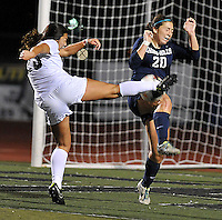 Aliso Niguel's Sarah Roberts, left, blasts the ball into her opponent while trying to score late in the second half of the championship game against Chino Hills. Aliso Niguel won 1-0.