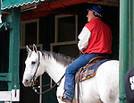 Assistant Trainer for Rachel Alexandra, Scott Blasi, waiting on shed row on his horse Pancho