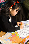 Education elementary school Grade 3 female student working on map making project