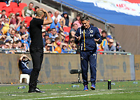 27th May 2018, Wembley Stadium, London, England;  EFL League 1 football, playoff final, Rotherham United versus Shrewsbury Town;  Shrewsbury Town manager Paul Hurst shrugging his shoulders towards Rotherham United manager Paul Warne from the touchline