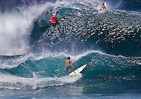 Surfersandbodyboarders in fast-paced action atBanzai PipelineonNorth Shore of Oahu.