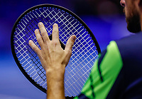 Rotterdam, Netherlands, December 12, 2017, Topsportcentrum, Ned. Loterij NK Tennis, Robin Haase (NED) tests his strings<br /> Photo: Tennisimages/Henk Koster