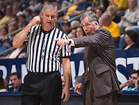 California's head coach Mike Montgomery points out the court with the referee during a game at Haas Pavilion in Berkeley, California on March 8th, 2014. California defeated Colorado 66 - 65