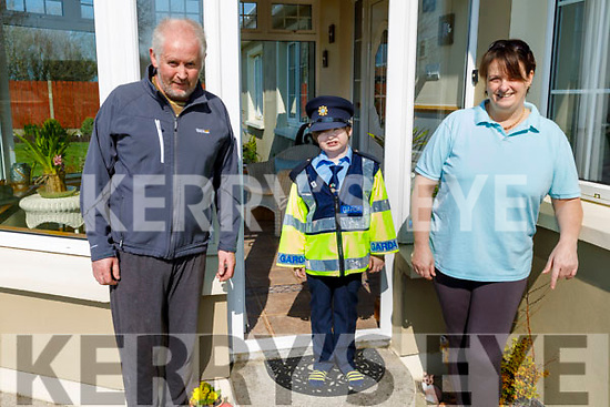 Sean Kearney with his mom and dad Tracey and John at home in Ardfert on Friday.