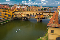 At about 1,000 years old, Ponte Vecchio, spanning the Arno River, is the oldest of the six bridges in Florence, Italy.  It is lined with many vendors, from trash and trinkets to fine art and jewelry stores.