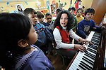 """THIS PHOTO IS AVAILABLE AS A PRINT OR FOR PERSONAL USE. CLICK ON """"ADD TO CART"""" TO SEE PRICING OPTIONS.   Sladjana Nedeljkovic, a Roma teacher at the Nasa Radost preschool in Smederevo, Serbia, leads children in singing. The children are all Roma, and most are from families who came to the area as refugees from Kosovo. The school's work is supported by Church World Service."""