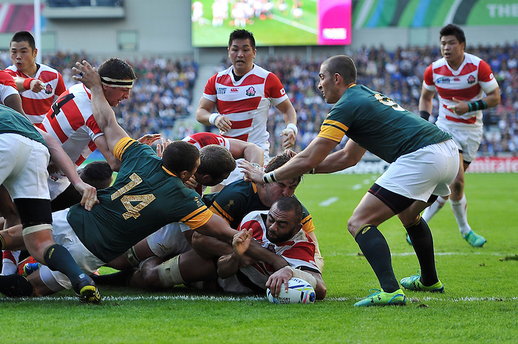 Michael Leitch of Japan reaches for the try-line. Rugby World Cup Pool B match between South Africa and Japan on September 19, 2015 at the Brighton Community Stadium in Brighton, England. Photo by: Patrick Khachfe / Stewart Communications