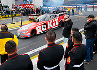 Feb 9, 2020; Pomona, CA, USA; US Marines look on as NHRA funny car driver Alexis DeJoria drives past father John Paul DeJoria during the Winternationals at Auto Club Raceway at Pomona. Mandatory Credit: Mark J. Rebilas-USA TODAY Sports