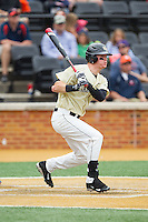 Conor Keniry (14) of the Wake Forest Demon Deacons follows through on his swing against the Virginia Cavaliers at Wake Forest Baseball Park on May 17, 2014 in Winston-Salem, North Carolina.  The Demon Deacons defeated the Cavaliers 4-3.  (Brian Westerholt/Four Seam Images)