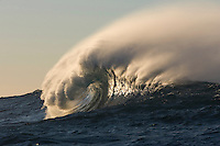 Afternoon offshore winds cause spray on a big wave.