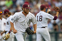 Mississippi State pitcher Trevor Fitts (31) runs to the dugout after being removed from the game during Game 1 of the 2013 Men's College World Series Finals against the UCLA Bruins on June 24, 2013 at TD Ameritrade Park in Omaha, Nebraska. The Bruins defeated the Bulldogs 3-1, taking a 1-0 lead in the best of 3 series. (Andrew Woolley/Four Seam Images)