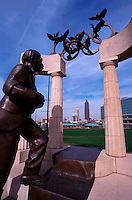 The Atlanta skyline as seen through a bronze sculpture commemorating the Olympic movement. Centennial Olympic Park Atlanta, Georgia.
