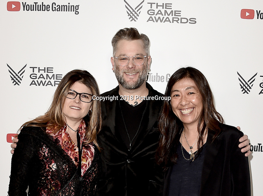 LOS ANGELES - DECEMBER 6: (L-R) Shannon Studstill, Cory Barlog and Yumi Yang attend the 2018 Game Awards at the Microsoft Theater on December 6, 2018 in Los Angeles, California. (Photo by Scott Kirkland/PictureGroup)