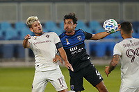 SAN JOSE, CA - SEPTEMBER 5: Clint Irwin #1 of the Colorado Rapids goes up for a header with Oswaldo Alanis #4 of the San Jose Earthquakes during a game between Colorado Rapids and San Jose Earthquakes at Earthquakes Stadium on September 5, 2020 in San Jose, California.