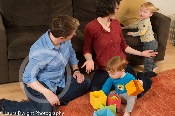 Fraternal twin boys, age 22 months, at home with parents