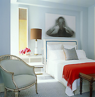 In the master bedroom the large print above the bed is a photographic work by Evan Caravelli and the adjacent painting is a piece by Leora Armstrong