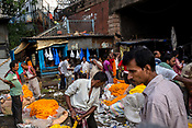 Vendors wait for customers at the Mullick Ghat Flower Market in the Howrah area of Kolkata, India, on Friday, May 26, 2017. Photographer: Sanjit Das