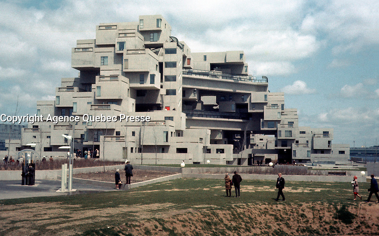 Montreal (Qc) CANADA - May 1967 File Photo -  Habitat 67 at the time of Expo 67 in Montreal.<br /> <br /> Habitat 67, is a model community and housing complex in Montreal, Canada designed by Israeli–Canadian architect Moshe Safdie. It was originally conceived as his master's thesis in architecture at McGill University and then built as a pavilion for Expo 67, the World's Fair held from April to October 1967. It is located at 2600 Avenue Pierre-Dupuy on the Marc-Drouin Quay next to the Saint Lawrence River.<br /> <br /> Habitat 67 is widely considered an architectural landmark and one of the most famous and significant buildings in Montreal