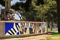 A side view of the musician-themed mosaic that surrounds the bandstand of South Gate Park.