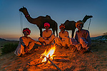 Evening fire, Pushkar Fair, Rajasthan, India<br /> <br /> As the sun disappears, temperatures in the desert plunge. This is time to connect with friends, and they will stay up all night talking. I photographed this approximately forty minutes after sunset, when the ambient light in the sky was the same degree as the firelight reflected on the men's white clothes.<br /> <br /> Canon EOS-1DS, EF17-40 mm f/4 lens, f/5.6 for 0.6 second, ISO 200