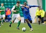 Hibs v St Johnstone....27.11.10  .Cleveland Taylor is fouled by Michael Hart.Picture by Graeme Hart..Copyright Perthshire Picture Agency.Tel: 01738 623350  Mobile: 07990 594431