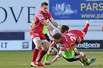 Munster replacement Jack O'Donoghue tackles Scarlets replacement Rhys Priestland.<br /> Guiness Pro12<br /> Scarlets v Munster<br /> 21.02.15<br /> ©Steve Pope -SPORTINGWALES