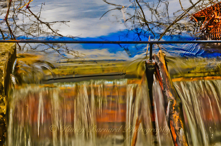 """""""OVER THE WEIR"""" <br /> <br /> This fall I sashayed up to Cranbrook, British Columbia to check out the autumn colors. I came across this water weir at a small pond and was intrigued by the water falling over the transom and the clouds reflected on the water. 24 x 36 signed, original, gallery wrapped wrapped canvas $2,500. Check for availability"""