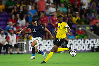 ORLANDO, FL - JULY 20: Adrian Martinez #16 of Costa Rica and Damion Lowe #17 of Jamaica battle for the ball during a game between Costa Rica and Jamaica at Exploria Stadium on July 20, 2021 in Orlando, Florida.