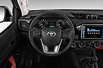 Car pictures of steering wheel view of a 2016 Toyota Hilux GL 4 Door Pickup Steering Wheel