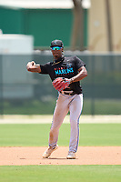 Miami Marlins second baseman Osiris Johnson (5) throwing during a Minor League Spring Training camp day on April 28, 2021 at Roger Dean Chevrolet Stadium Complex in Jupiter, Fla.  (Mike Janes/Four Seam Images)