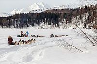 Michelle Phillips runs down the Skwentna River as Lance and Jason Mackey rest their teams during the 2016 Iditarod between the Finger Lake and Rainy Pass Checkpoints.  Alaska.  March 07, 2016.  <br /> <br /> Photo by Jeff Schultz (C) 2016 ALL RIGHTS RESERVED