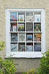 Second hand book shop window. Books displayed in shop window. Hay on Wye, Hereford and Worcester England 2009.