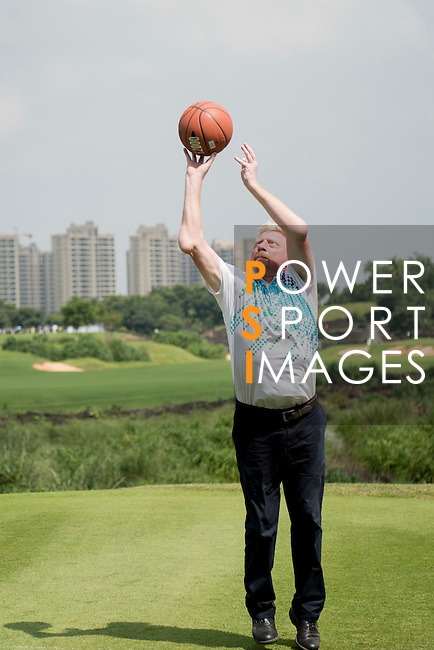 Boris Becker throws a basketball during the World Celebrity Pro-Am 2016 Mission Hills China Golf Tournament on 23 October 2016, in Haikou, Hainan province, China. Photo by Weixiang Lim / Power Sport Images