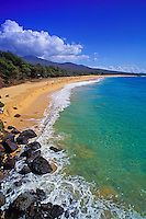 A secluded stretch of crescent shaped white sand at Makena Beach, looking south.