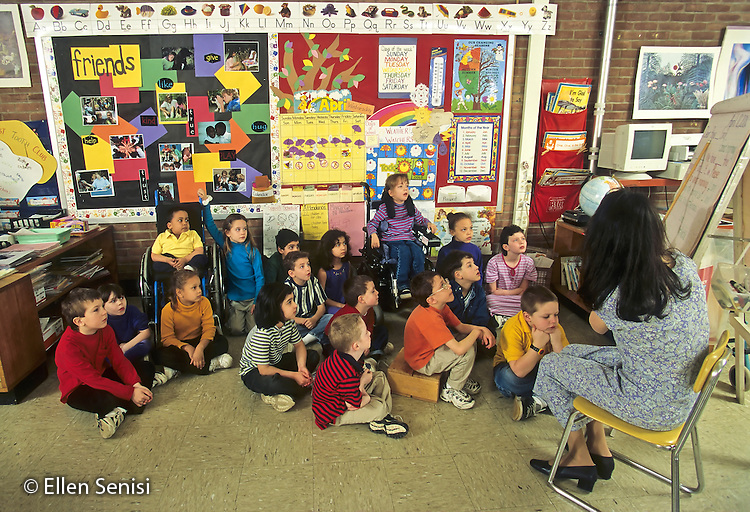 MR / Schenectady, New York. Zoller Public School / Grade 1 Inclusion classroom. Teacher with class group. About one quarter of class includes mainstreamed special education students with mixed disabilities including learning disability, ADHD, spina bifida, scoliosis, and cerebral palsy. MR: MF © Ellen B. Senisi