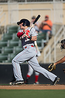 Trent Kemp (17) of the Greenville Drive follows through on his swing against the Kannapolis Intimidators at Intimidators Stadium on June 7, 2016 in Kannapolis, North Carolina.  The Drive defeated the Intimidators 4-1 in game one of a double header.  (Brian Westerholt/Four Seam Images)